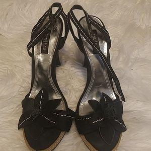 Shoes by black house black market.